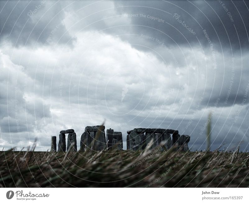 Stonehenge II Colour photo Subdued colour Exterior shot Deserted Work of art Storm Wind Gale England Tourist Attraction Landmark Monument Old Threat Famousness