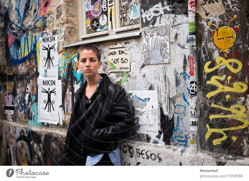 Young short hair woman in urban environment and graffiti Lifestyle Apprentice University & College student Human being Woman Adults 1 18 - 30 years
