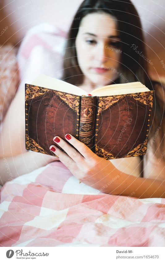 young woman reads book in bed Book Reading Woman Young woman girl Study Novel thrilling Bookworm Shackled Bed Duvet Cozy concentrated hobby stay at home