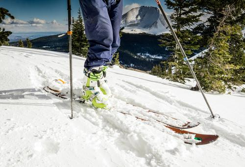 Skis and ski boots Leisure and hobbies Skier Skiing Vacation & Travel Trip Adventure Expedition Winter Snow Mountain Legs 1 Human being Peak Snowcapped peak