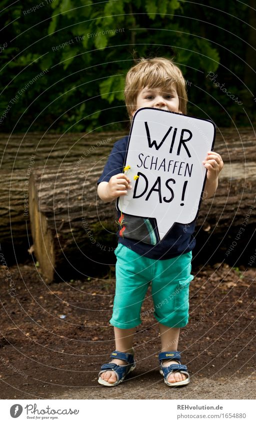 Child holds a speech bubble in the forest Human being Masculine Toddler Boy (child) 1 1 - 3 years Environment Nature Forest Characters Signs and labeling