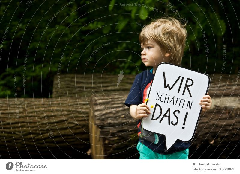 Toddler holding a speech bubble Human being Masculine Child Boy (child) 1 1 - 3 years Environment Nature tree Forest Bravery Determination Compassion Goodness