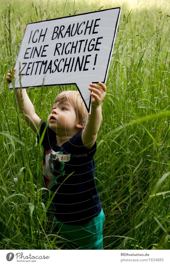 I need a real time machine. Human being Masculine Child Toddler Boy (child) 1 1 - 3 years Environment Nature Grass Meadow Characters Signs and labeling Signage