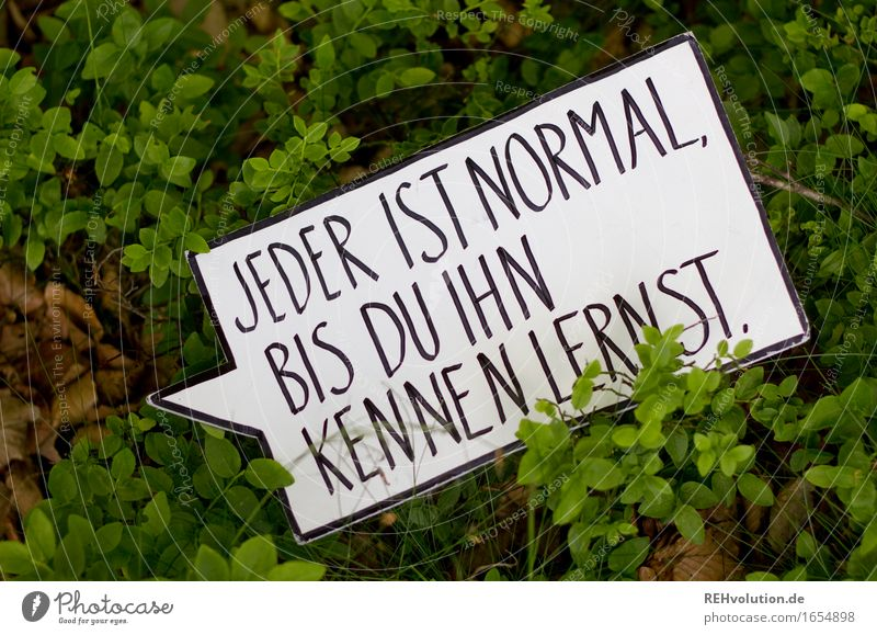 Everyone is normal ... Environment Nature Bushes Foliage plant Forest Sign Characters Signs and labeling Signage Warning sign Exceptional Green Compassion
