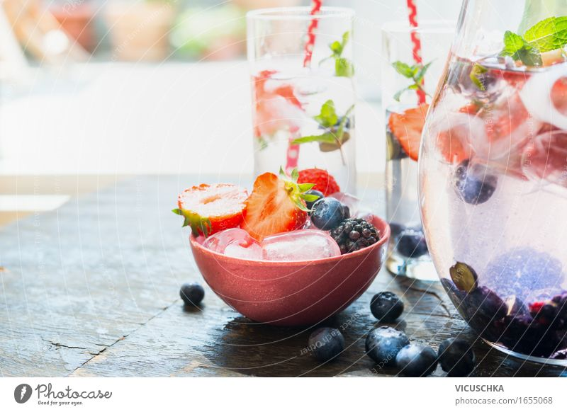 Ice cubes and berries in bowl on the garden table Food Fruit Dessert Ice cream Beverage Cold drink Drinking water Lemonade Juice Bowl Glass Style Design