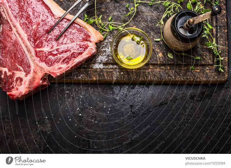 T- bone steak with oil and spices for grilling or roasting Food Meat Herbs and spices Cooking oil Nutrition Lunch Dinner Buffet Brunch Business lunch Picnic