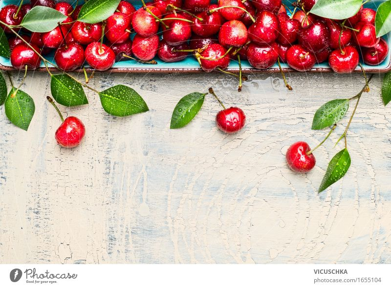 Sweet cherries with green leaves on light wood Food Fruit Nutrition Organic produce Vegetarian diet Style Design Healthy Eating Life Summer Garden Table Nature