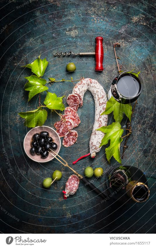 Italian food with salami, red wine, vine leaves and olives Food Sausage Nutrition Lunch Buffet Brunch Picnic Italian Food Beverage Wine Plate Bowl Bottle Glass