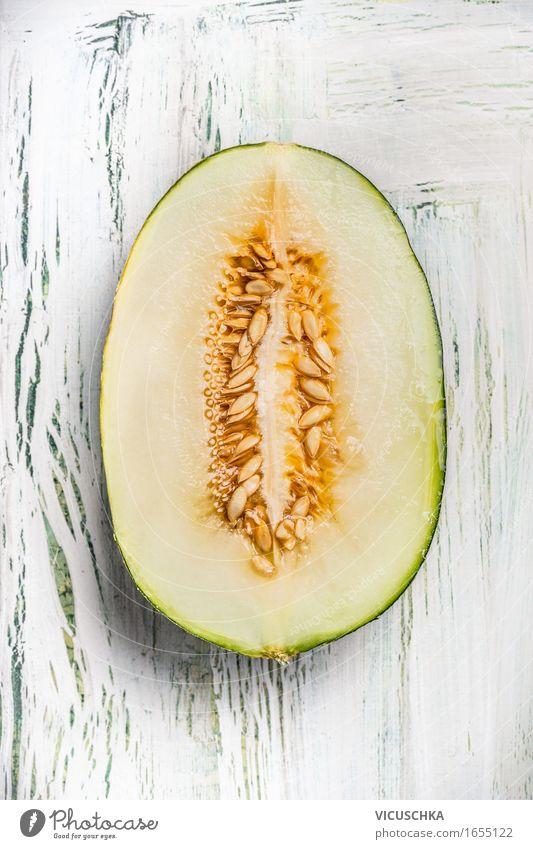 Half the melon with seeds Food Fruit Dessert Nutrition Organic produce Vegetarian diet Diet Style Healthy Eating Life Summer Table Yellow Design Honeydew Seed