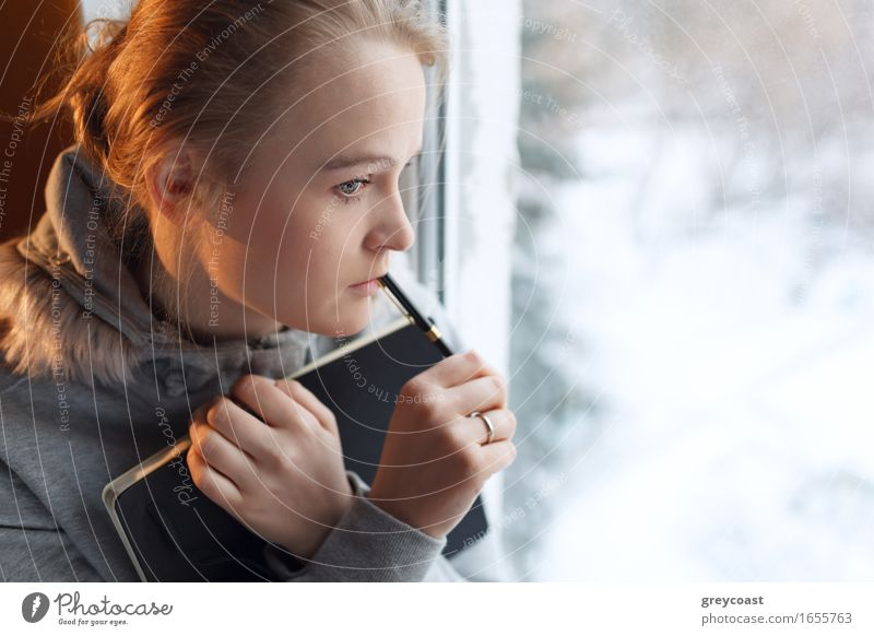 Young girl in a deep thoughts Human being Woman Youth (Young adults) Young woman Loneliness Girl Winter 18 - 30 years Face Adults Warmth Love Think Business Flat (apartment) Dream