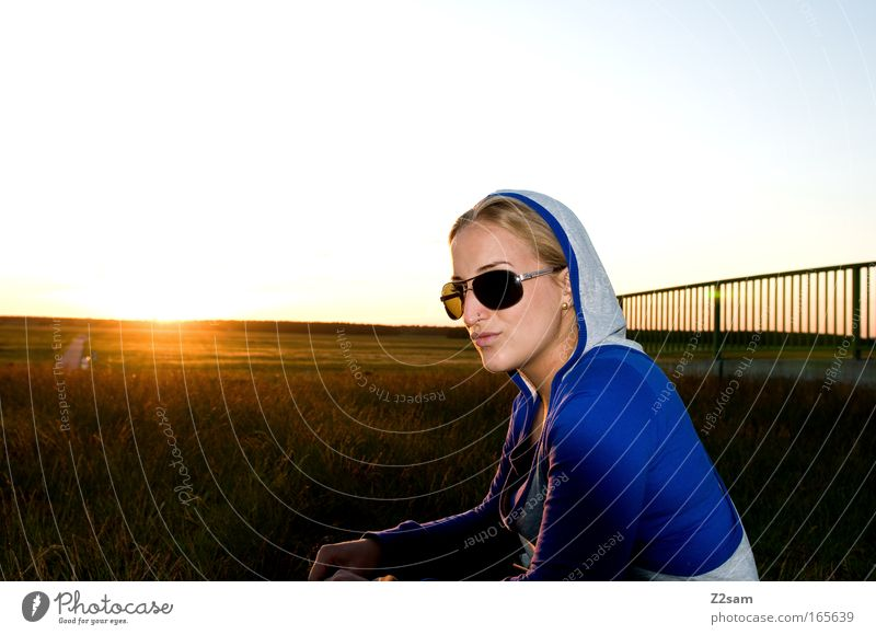 sunshine Colour photo Exterior shot Looking away Feminine 1 Human being 18 - 30 years Youth (Young adults) Adults Landscape Sunrise Sunset Bridge Sunglasses