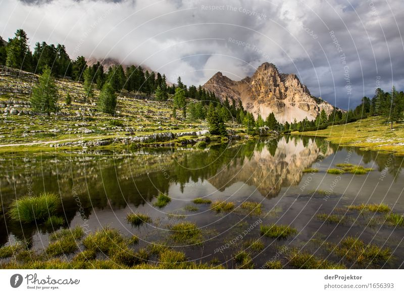 Reflection of a mountain in the Dolomites Central perspective Deep depth of field Sunbeam Sunlight Light (Natural Phenomenon) Silhouette Contrast Shadow Day