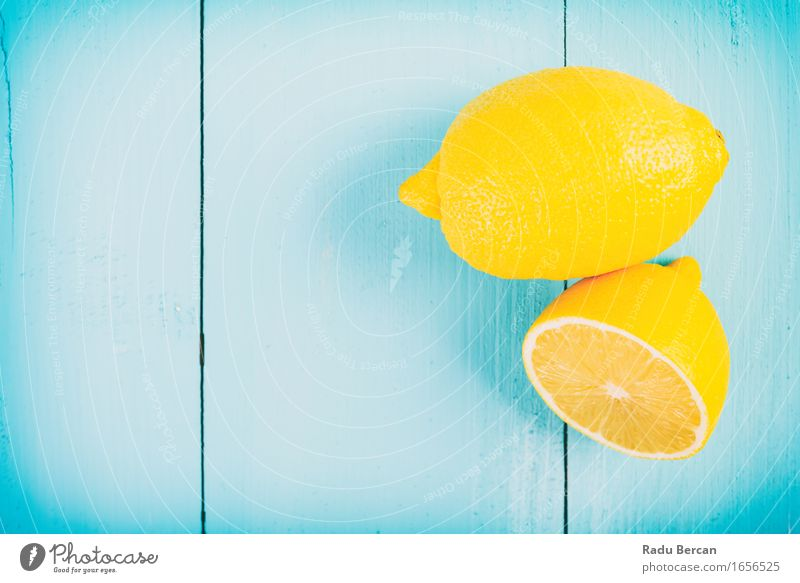 Fresh Yellow Lemons On Wooden Table Food Fruit Nutrition Eating Breakfast Organic produce Vegetarian diet Diet Nature Simple Exotic Delicious Juicy Sour Blue