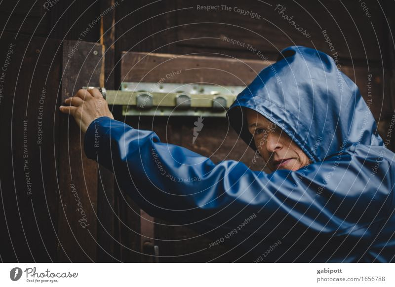 Door opener | AST 9 Human being Feminine Woman Adults Life Facade Blue Brown Lock Closed Weather Weather protection Rain jacket Wet Arise Caution Colour photo
