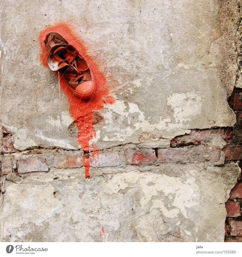 Red Colour Wall (building) Stone Wall (barrier) Building Footwear Graffiti Art Facade Uniqueness Sneakers Plaster