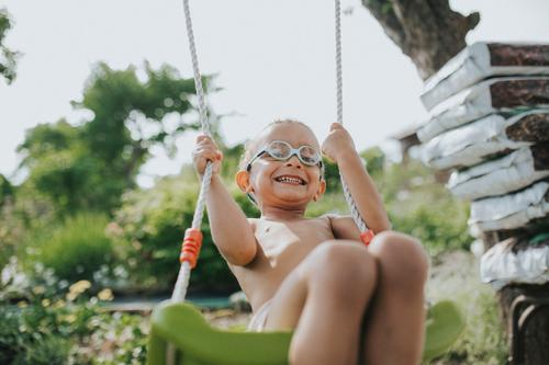 ° Life Contentment Playing Swing Freedom Summer Garden Human being Toddler Boy (child) Infancy 1 1 - 3 years Eyeglasses Movement Laughter To swing Illuminate