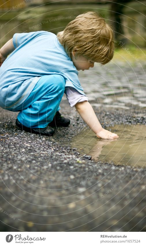 Human being Child Nature Blue Water Joy Environment Movement Boy (child) Playing Small Happy Masculine Contentment Infancy Wet