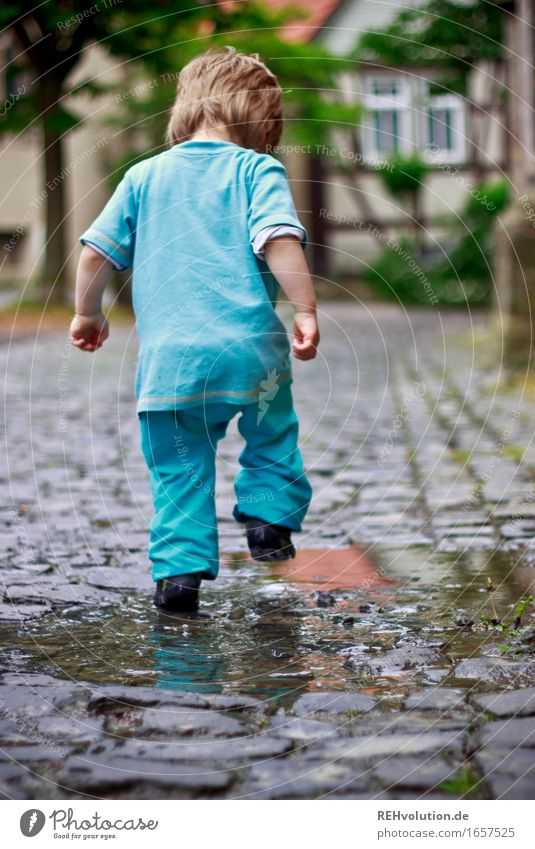 Human being Child Blue Joy Funny Movement Boy (child) Playing Small Happy Jump Masculine Contentment Infancy Happiness Walking