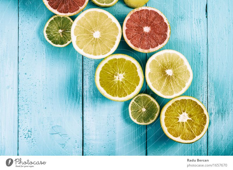 Lime, Lemons, Oranges And Grapefruit Fruits On Turquoise Table Blue Green Colour Healthy Eating Red Yellow Food Contentment Nutrition Energy Fitness