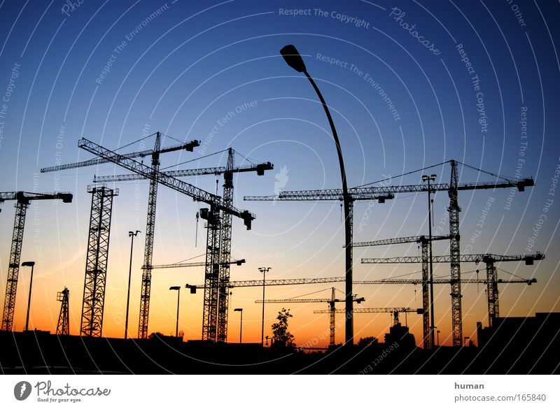 The sun sets and the cranes rise Berlin Germany Europe Manmade structures Site Build Esthetic Sharp-edged Simple Far-off places Gigantic Large New Beautiful