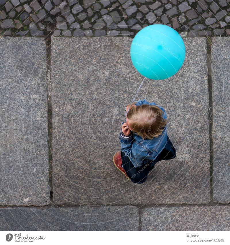 Human being Child Blue Joy Street Playing Freedom Happy Blonde Flying Balloon Round Infinity Curiosity Infancy