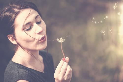 young woman blows on a dandelion Lipstick Nail polish Leisure and hobbies Vacation & Travel Far-off places Freedom Hiking Human being Feminine Child Young woman