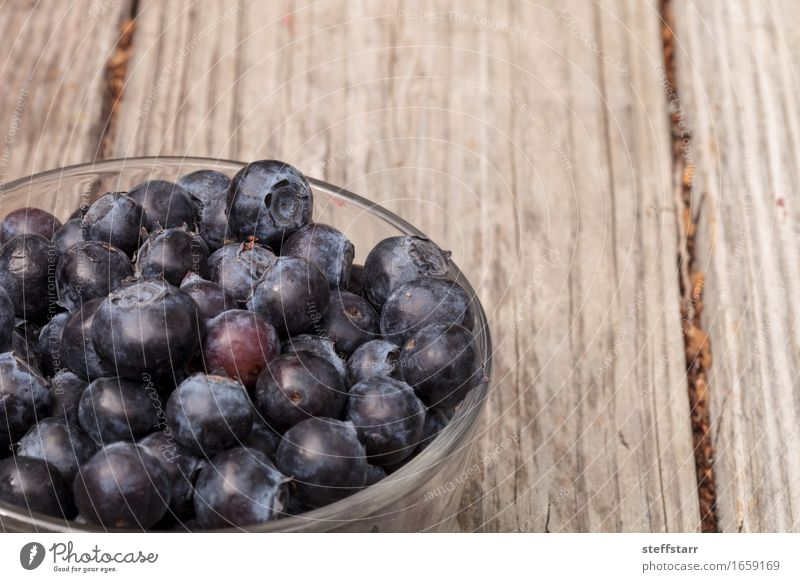 Clear glass bowl of ripe blueberries Food Fruit Nutrition Eating Breakfast Picnic Organic produce Vegetarian diet Diet Bowl Plant Blue Colour photo Morning Dawn