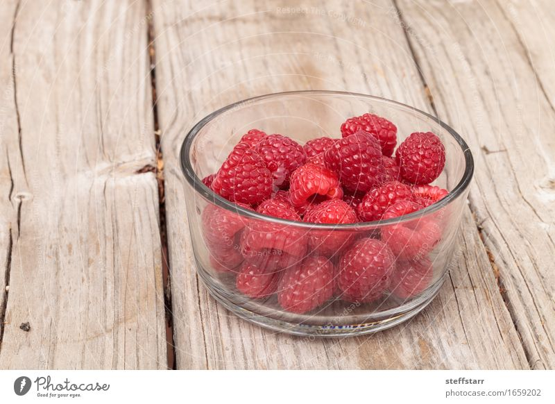 Clear glass bowl of ripe raspberries Food Fruit Nutrition Eating Breakfast Organic produce Vegetarian diet Diet Healthy Wellness Life Well-being Plant Pink Red