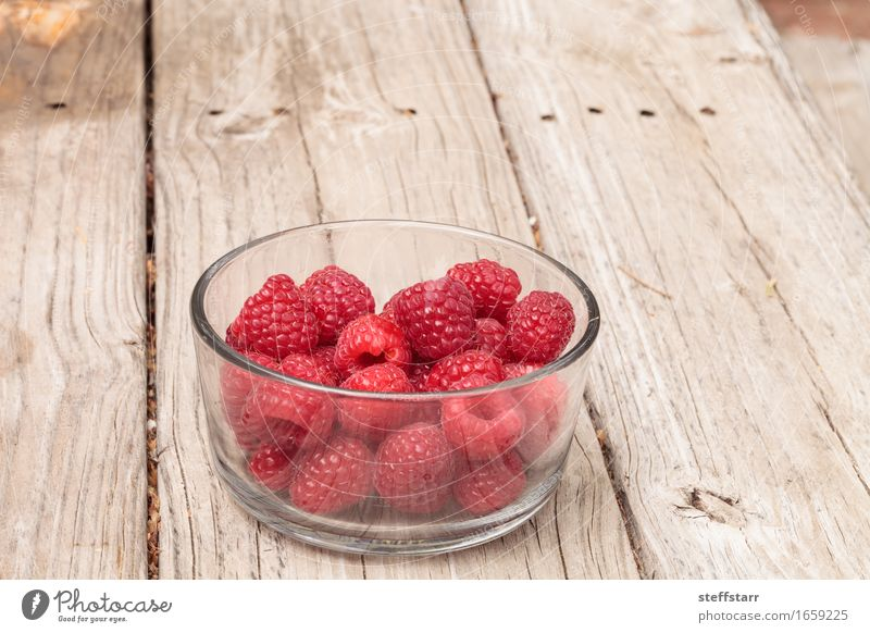 Clear glass bowl of ripe raspberries Plant Beautiful Red Eating Healthy Food Pink Fruit Nutrition Glass Breakfast Bowl Diet Picnic