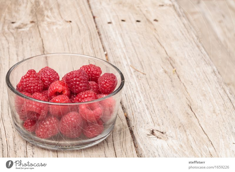 Clear glass bowl of ripe raspberries Plant Red Eating Healthy Wood Food Pink Fruit Nutrition Glass Breakfast Bowl Diet Picnic