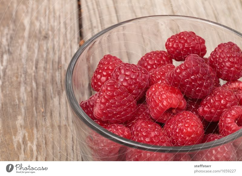 Clear glass bowl of ripe raspberries Plant Beautiful Red Food Pink Fruit Nutrition Glass Skin Breakfast Bowl Vegetarian diet Diet Picnic