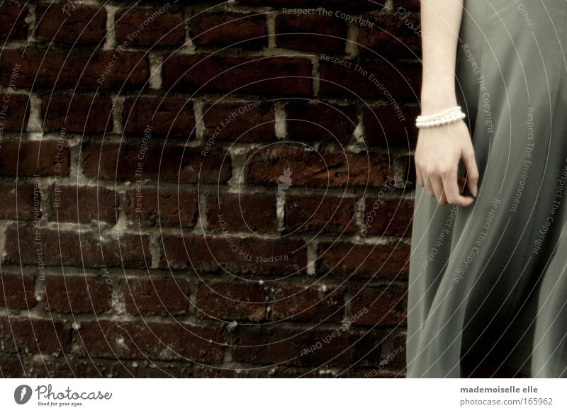 Woman Human being Youth (Young adults) Adults Loneliness Feminine Wall (building) Emotions Stone Sadness Wall (barrier) Dream Fashion Wind Arm