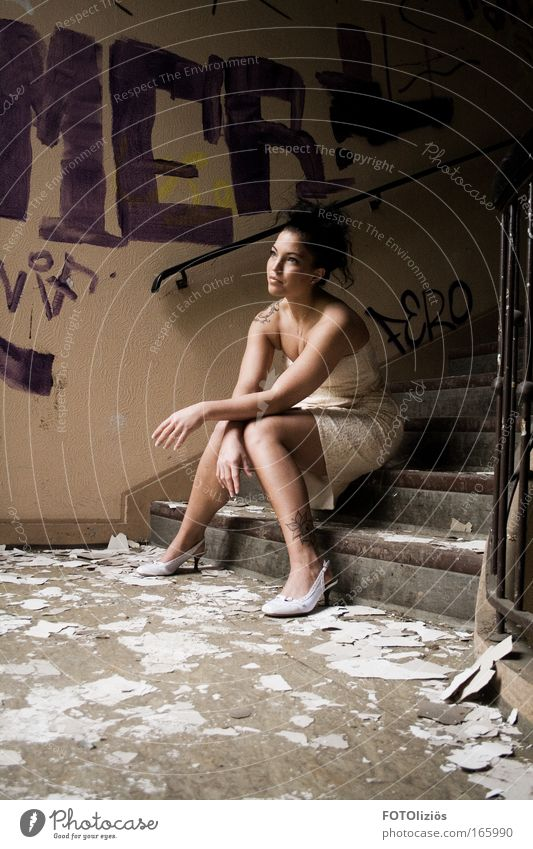 Woman Human being Youth (Young adults) Adults Feminine Wall (building) Graffiti Hair and hairstyles Footwear Stone Building Think Wall (barrier) Legs Fashion