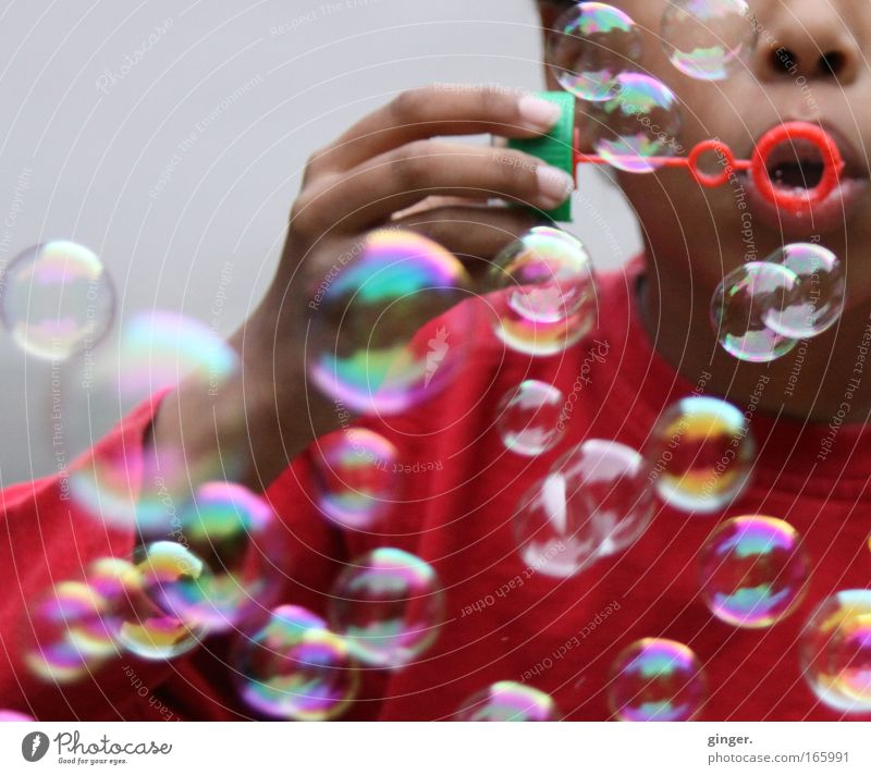Blow it fast! Leisure and hobbies Playing Human being Child Boy (child) Arm Hand 1 Multicoloured Joy Happiness Dazzling Red Mouth Air Round Soap bubble Glimmer