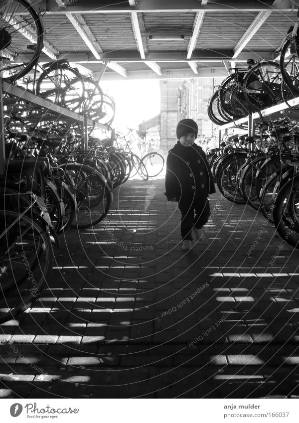 Bicycle Shed Human being Child City Environment Boy (child) Infancy Bicycle Walking Transport Uniqueness Toddler Vehicle Black & white photo Morning 1 - 3 years