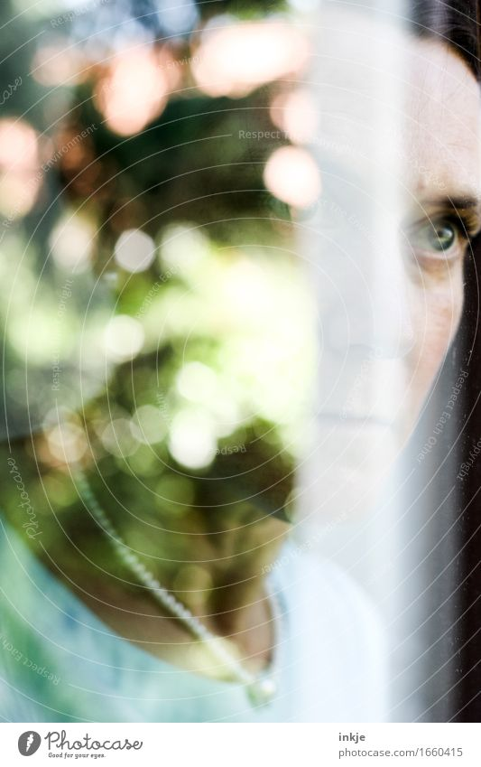 Portrait of a woman reflected in the window pane Lifestyle Style Woman Adults Face 1 Human being Spring Summer Beautiful weather Window Mirror image blurriness