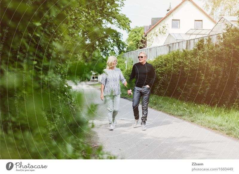 Retired couple out for a walk Leisure and hobbies Female senior Woman Male senior Man Couple Partner 60 years and older Senior citizen Landscape Summer