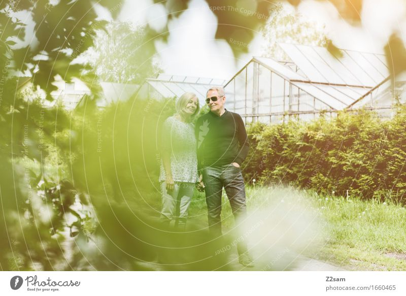 Well camouflaged Female senior Woman Male senior Man Couple Partner 60 years and older Senior citizen Nature Landscape Sunlight Summer Beautiful weather Bushes