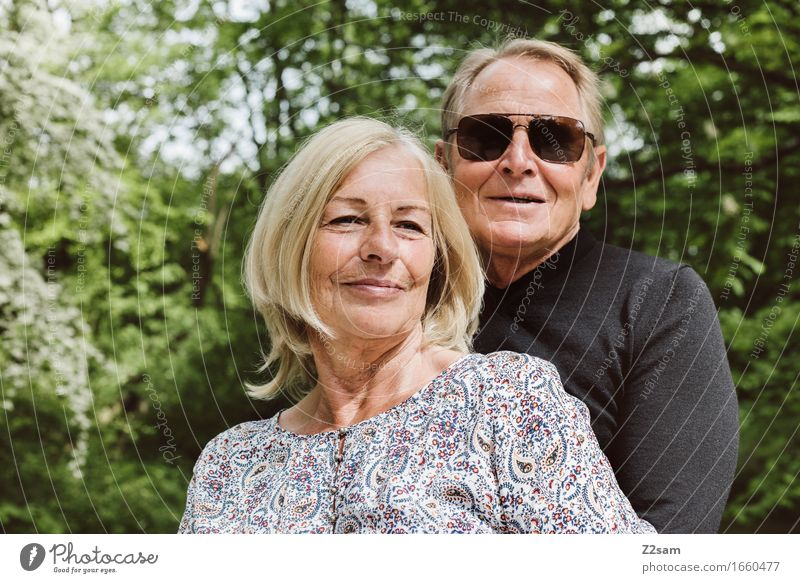 Retired couple in the green Lifestyle Female senior Woman Male senior Man Couple Partner 60 years and older Senior citizen Nature Landscape Sun Summer