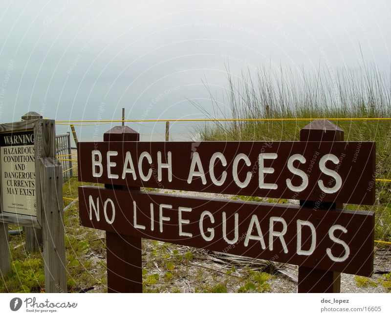 at your own risk Beach Bay watch Ocean Bad weather Leisure and hobbies Signs and labeling Beach dune Warning label Signage
