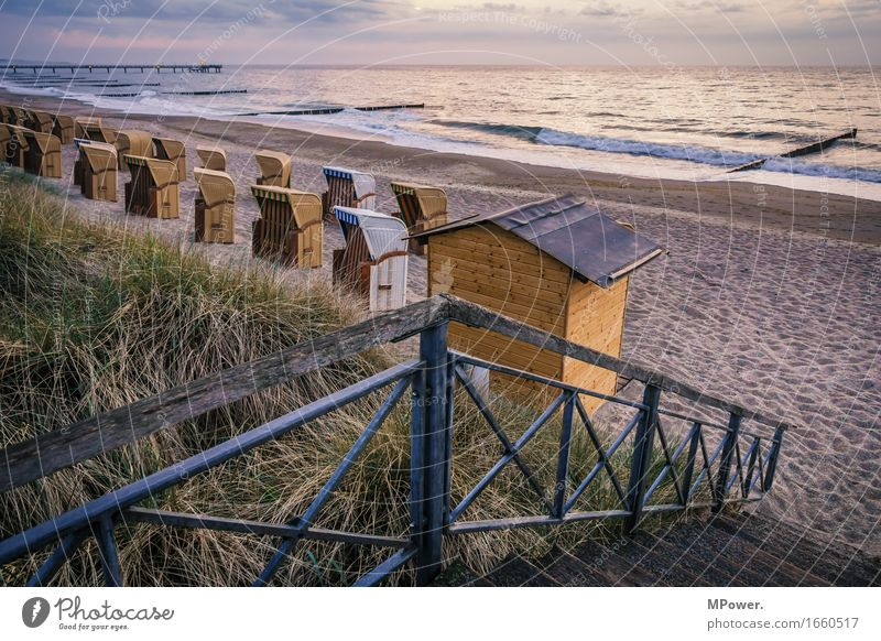 on the beach Environment Landscape Bad weather Thunder and lightning Plant Grass Waves Beach Bay Baltic Sea Ocean Island Kitsch Vacation & Travel Beach chair
