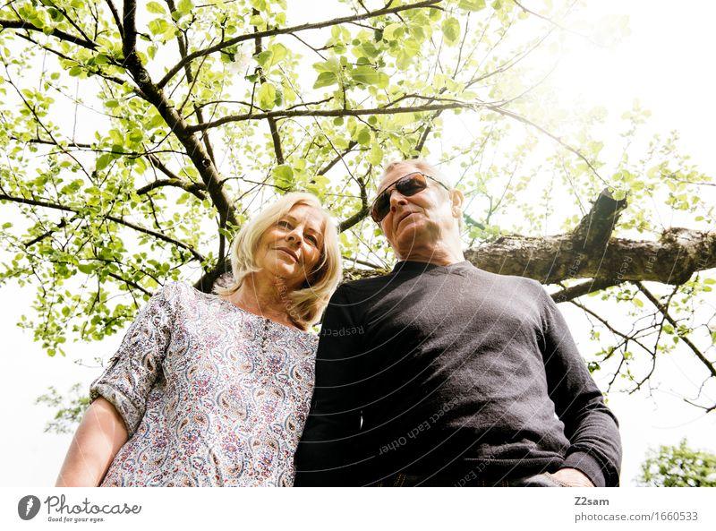 twosome Lifestyle Elegant Style Couple Partner 60 years and older Senior citizen Environment Nature Landscape Sun Spring Summer Beautiful weather Tree Bushes