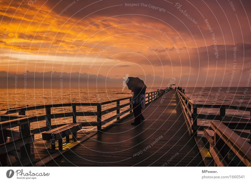On the pier Beautiful weather Bad weather Wind Baltic Sea Footbridge Dusk Glow Waves Ocean Coast wood Red Calm Relaxation Vantage point Vacation & Travel Card