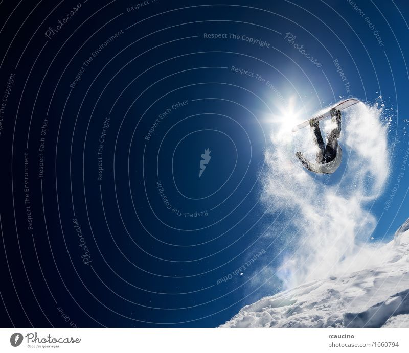 Snowboarder making high jump in clear blue sky Lifestyle Joy Vacation & Travel Sun Winter Mountain Sports Man Adults Sky Jump Cool (slang) Blue White Dangerous