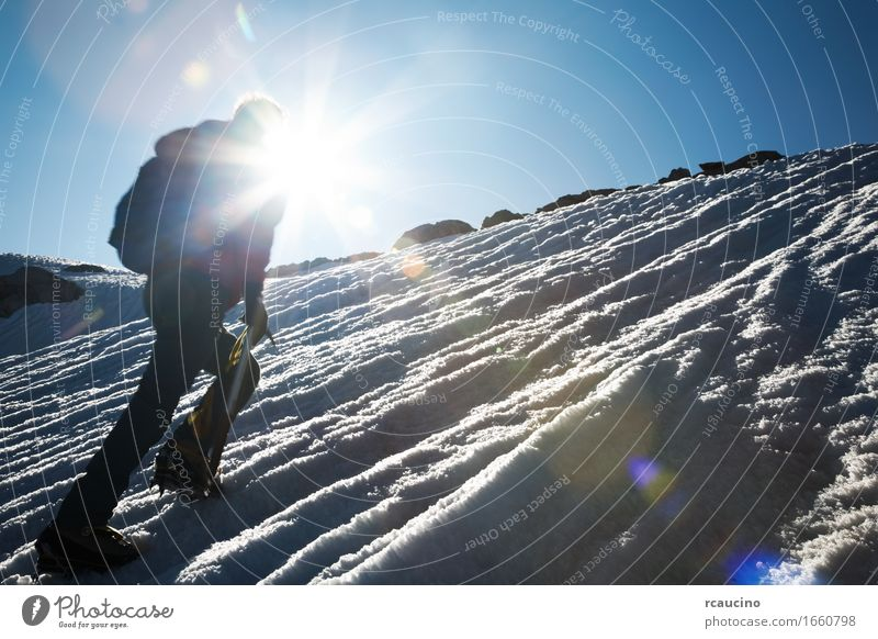 Mountain climber climbing a snowy ridge Adventure Expedition Winter Snow Hiking Sports Climbing Mountaineering Success Man Adults Nature Landscape Alps Peak