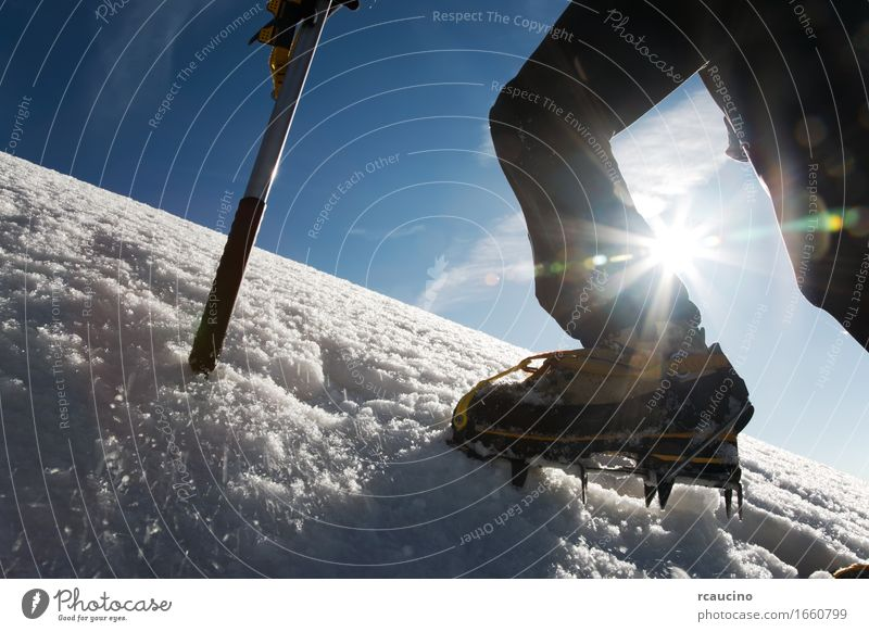 Mountain climber: detail on boot with ice crampon and ice axes Nature Man Loneliness Winter Adults Sports Snow Hiking Action Success Dangerous Adventure