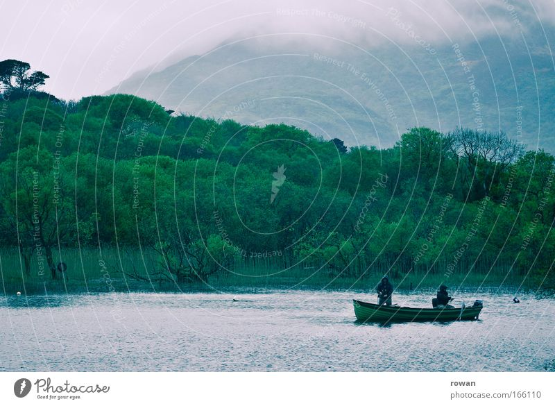 patience Colour photo Subdued colour Copy Space top Fishing (Angle) Wait Wet Cold Patient Watercraft Lake Lakeside Rain Fog Green Mountain lake Angler