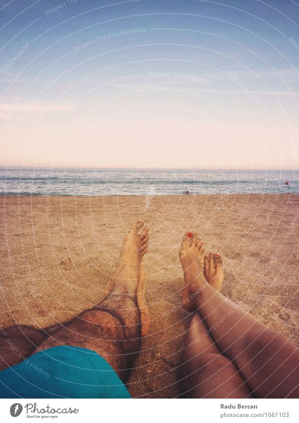 Loving Couple Relaxing On Ocean Beach At Sunset Well-being Relaxation Summer Summer vacation Sunbathing Human being Masculine Feminine Young woman
