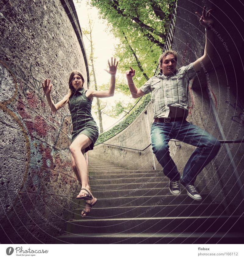 Woman Man Youth (Young adults) City Adults Jump Flying Concrete Stairs Dangerous Action Cool (slang) Profession Threat Sudden fall Brave