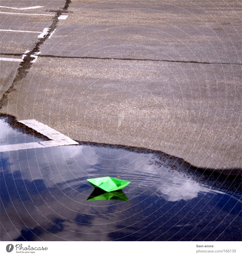green before grey on blue Colour photo Exterior shot Deserted Day Handicraft Children's game Cruise Waves Water Joy Playing Toys Parking lot Paper boat Green